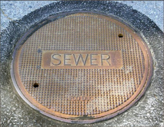 May contain: sewer, drain, manhole, and hole