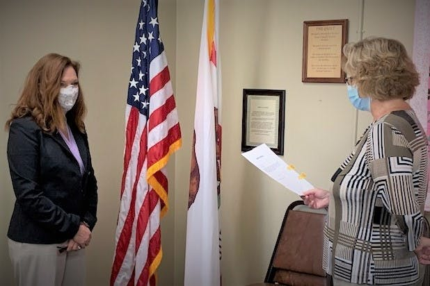 Lori Hack is sworn into office by President, Lin Reed on 8/26/2020