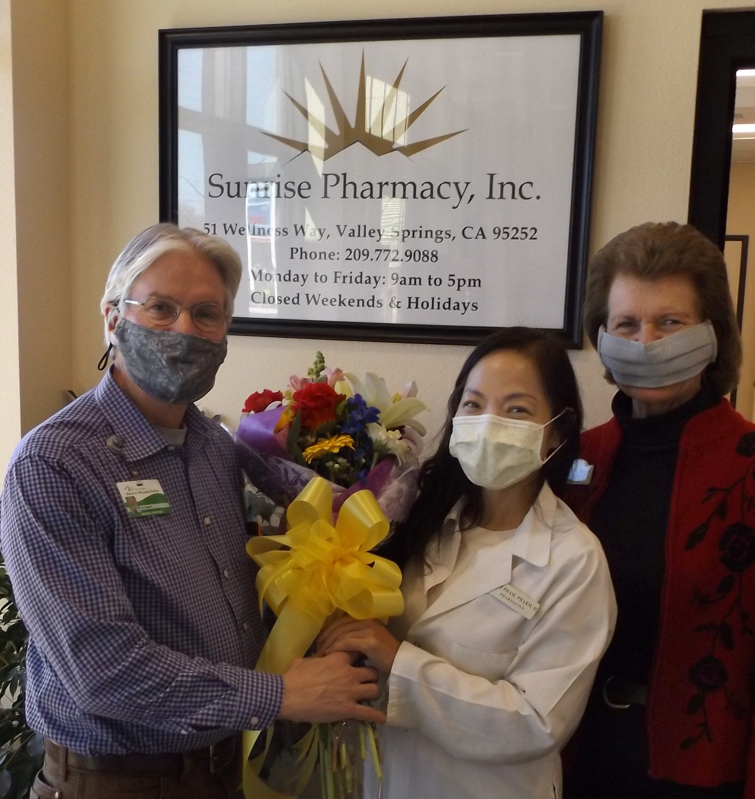 Dr. Randy Smart, Mark Twain Health Care District executive director, and Peggy Stout, MTHCD executive assistant, welcome Pharmacist Kim Pham, center, to the Valley Springs Health and Wellness Center.