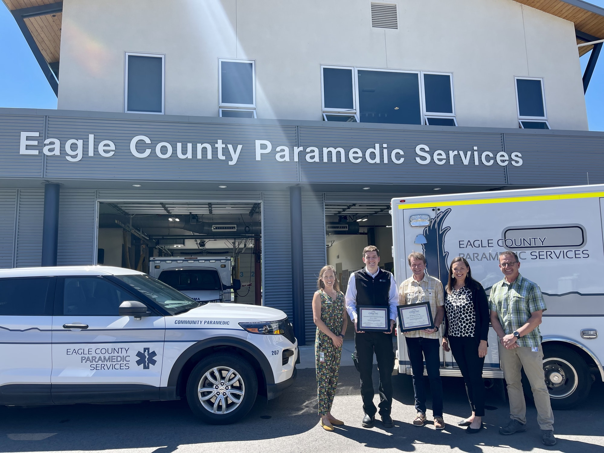 Amy Gnojek, David Miller, Jim Bradford, Sarah Weatherred, Steve Vardaman in front of a CP vehicle and amublance