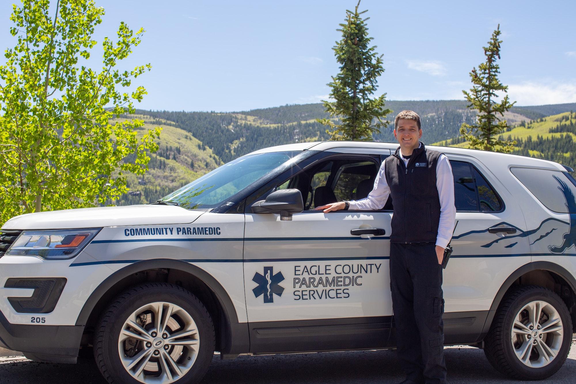 Community Paramedic David Miller standing in front of a community paramedic specific SUV