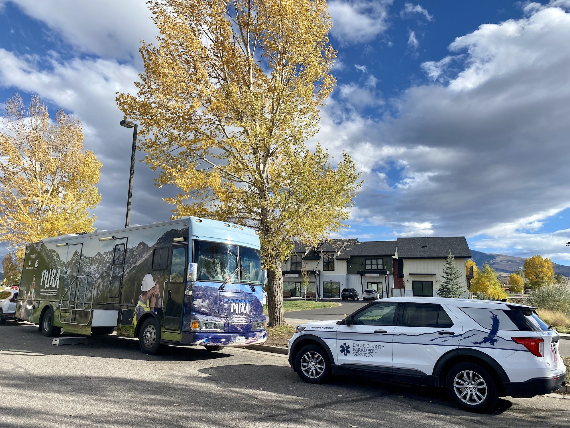 Photo of MIRA bus along with Eagle County Paramedics Community Paramedic in front of Ridley's Grocery store in Gypsum