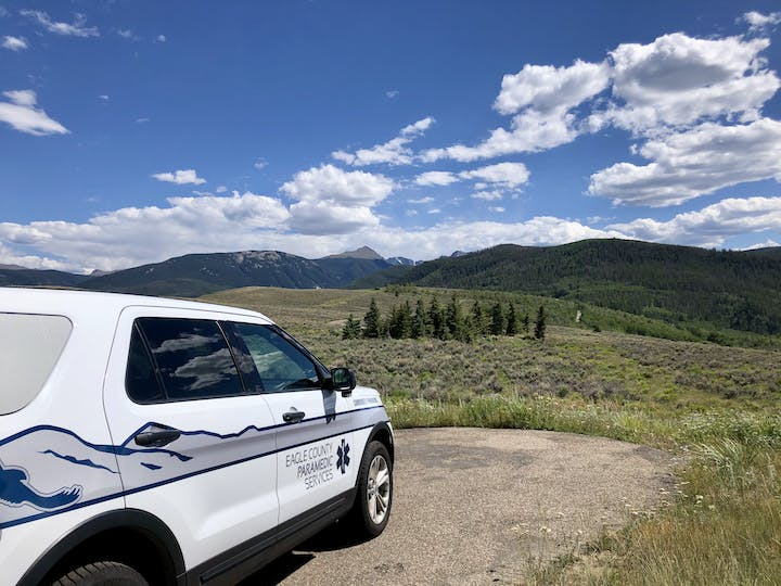 Community Paramedic SUV parked at a scenic overlook