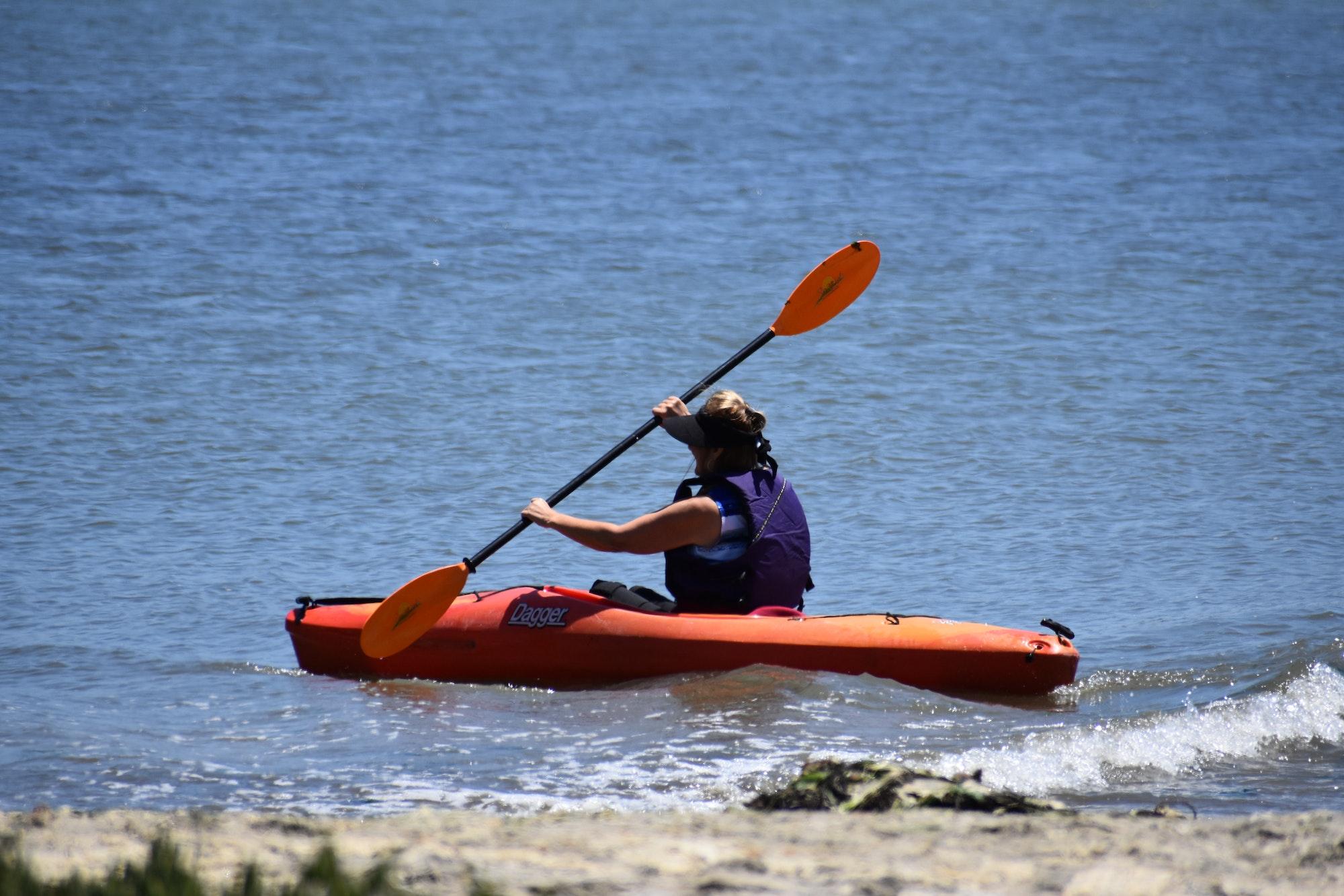 May contain: human, person, oars, transportation, vehicle, boat, rowboat, canoe, kayak, and paddle