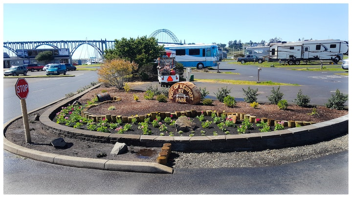 Sign and planting at the entrance into the Marina RV Park