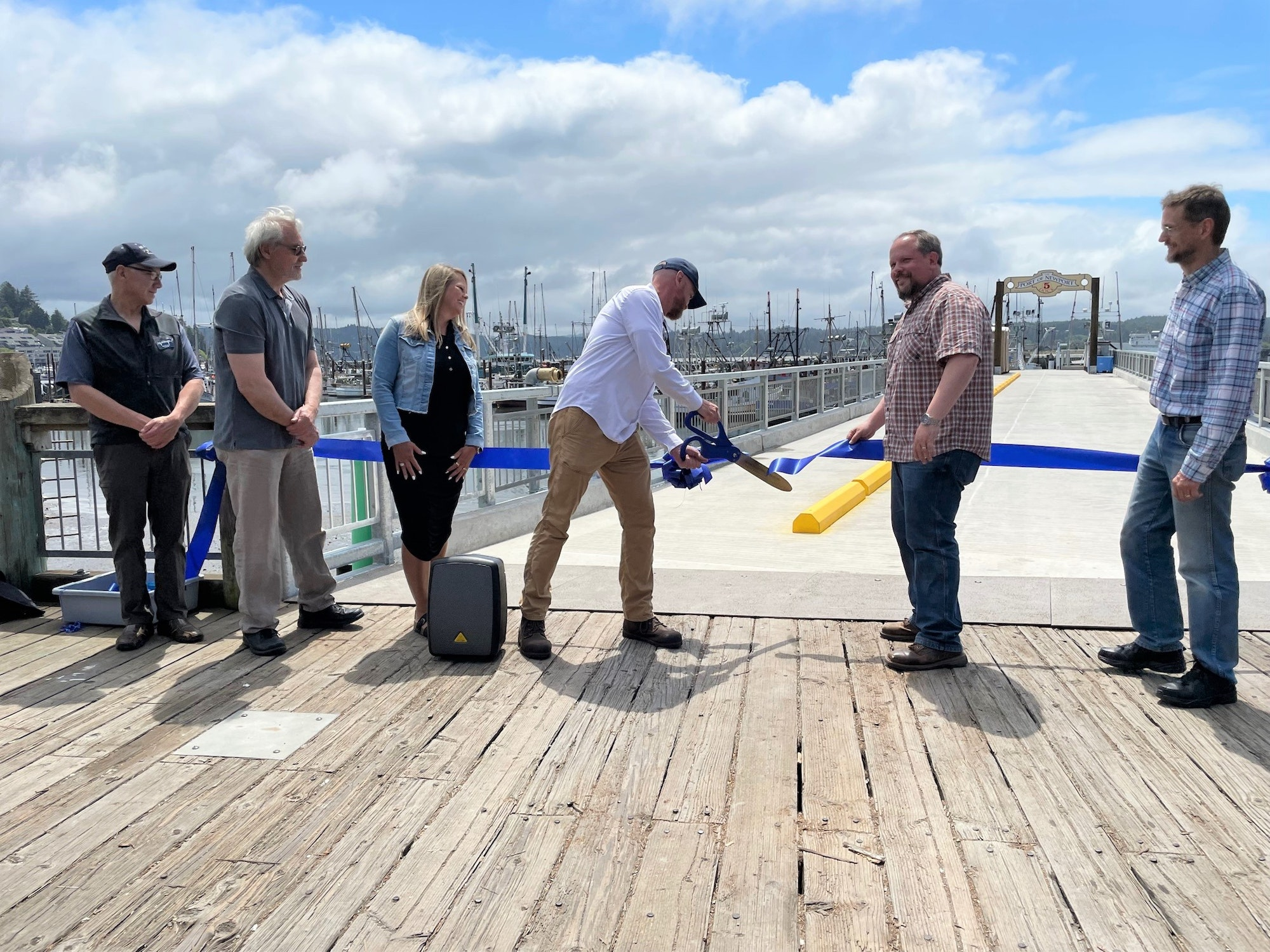 Port Commission President cuts the ribbon to officially open the pier.