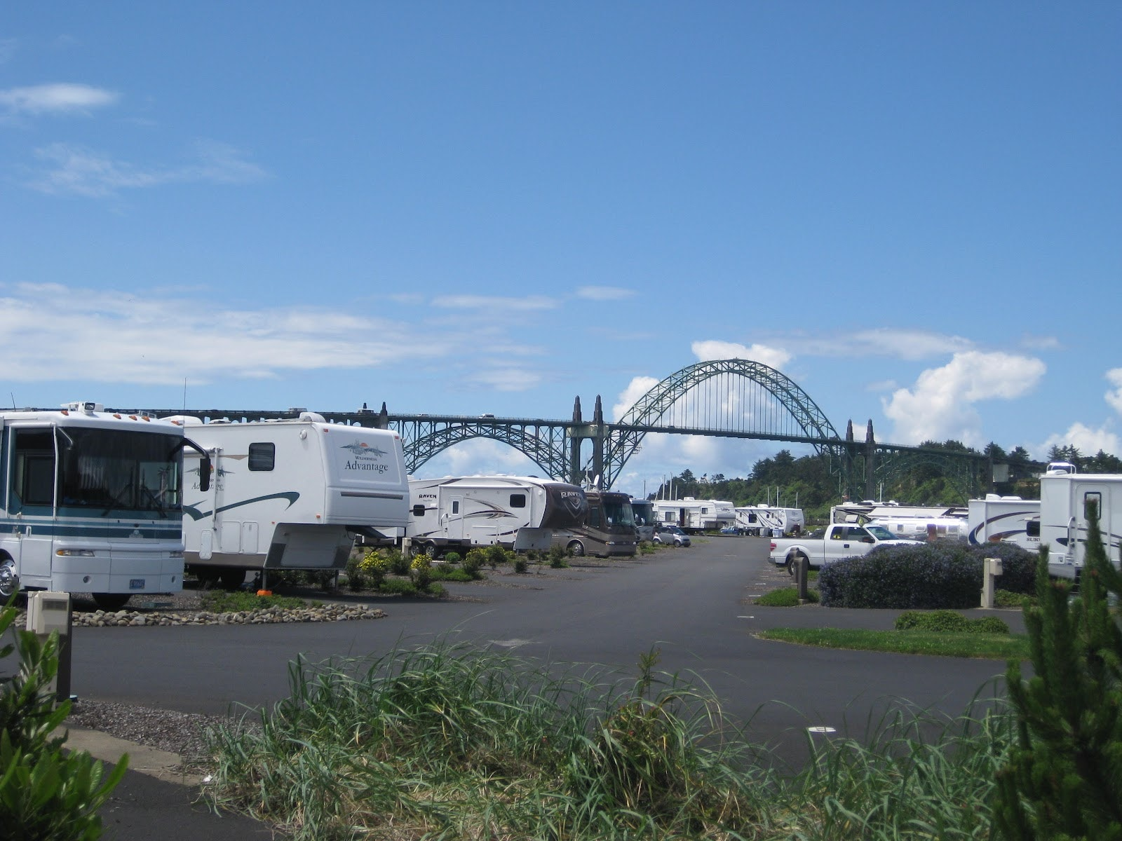 RVs with Yaquina Bay Bridge in the background