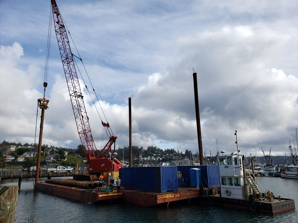 May contain: construction crane, boat, transportation, and vehicle