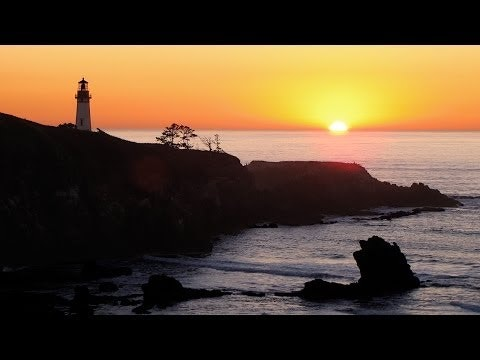 Sunrise over the ocean with lighthouse