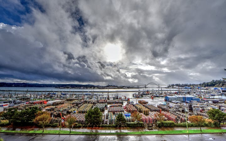 sun breaking through clouds overlooking commercial crab pots at PD7