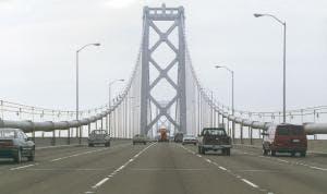 May contain: building, bridge, road, and suspension bridge