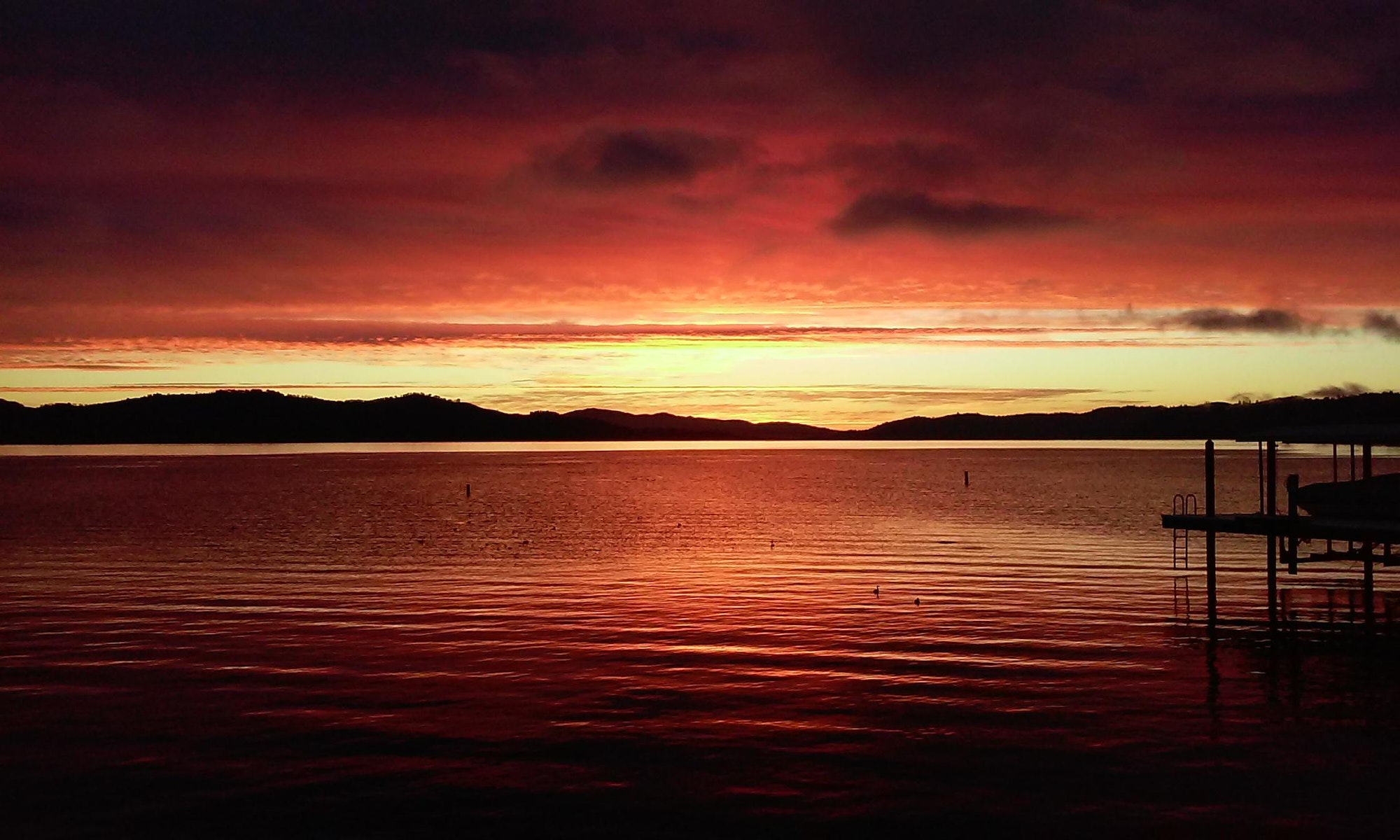 Red, orange and yellow sunrise over Clearlake
