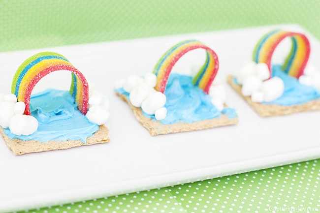 Rainbow weather snack; graham cracker with blue frosting, mini marshmallow clouds and airheads extremes rainbow