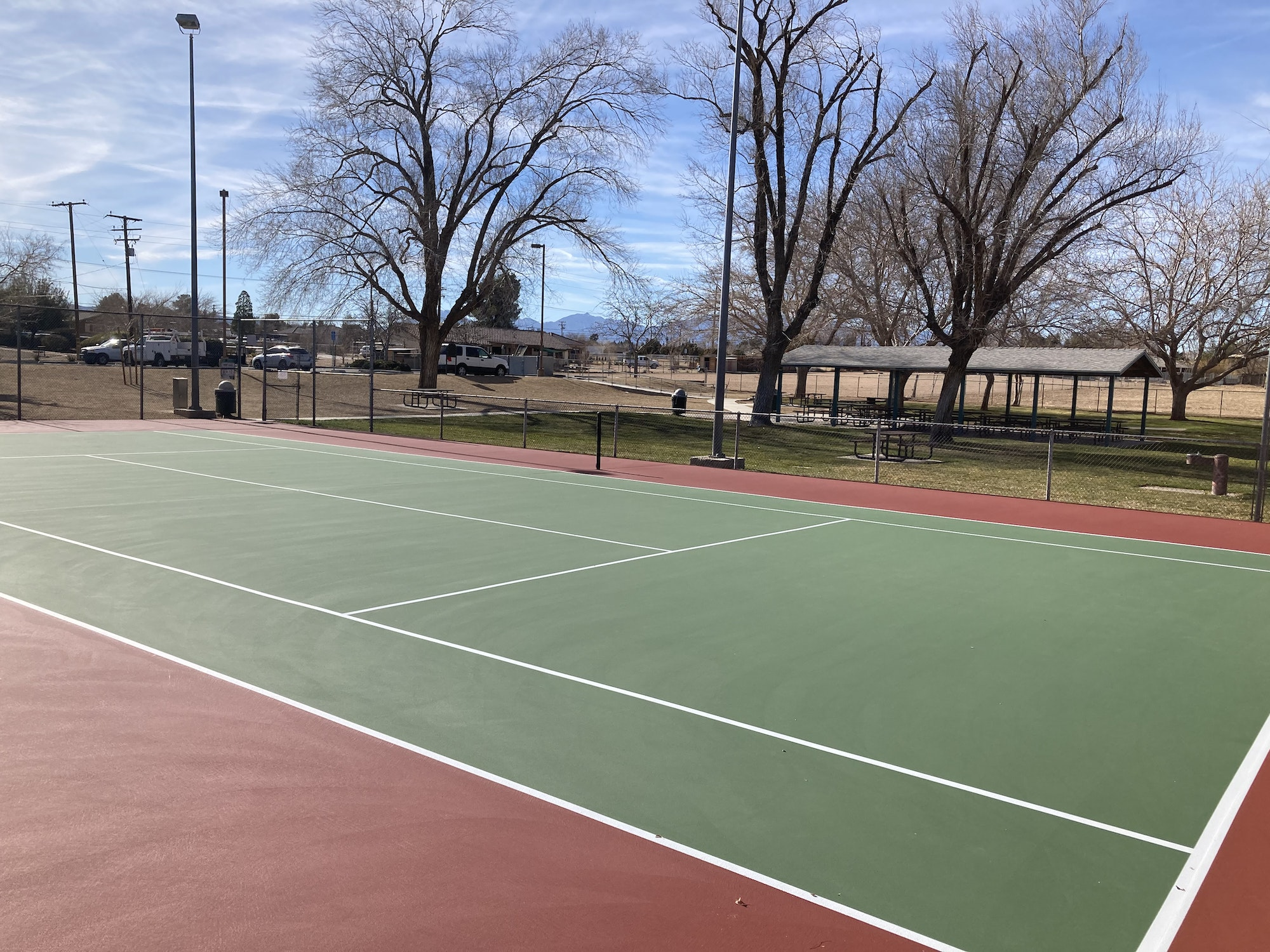 May contain: tennis court, sport, and sports