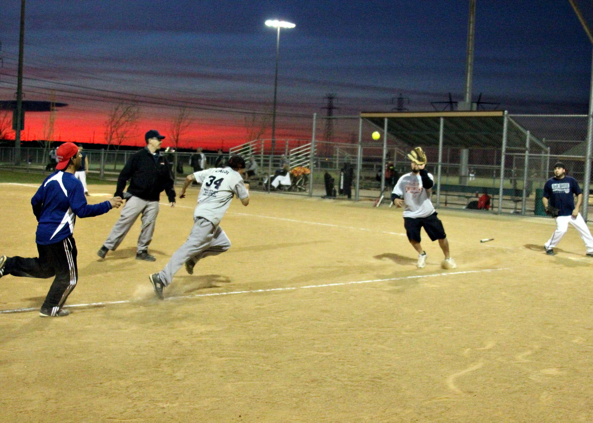 Adult softball game in action