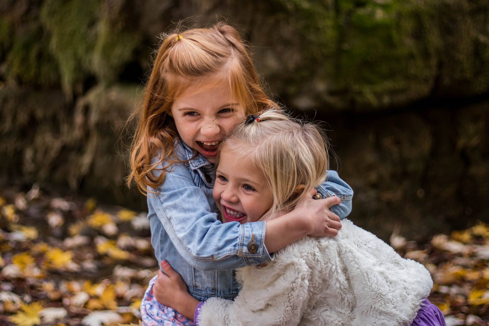Two little girls hugging