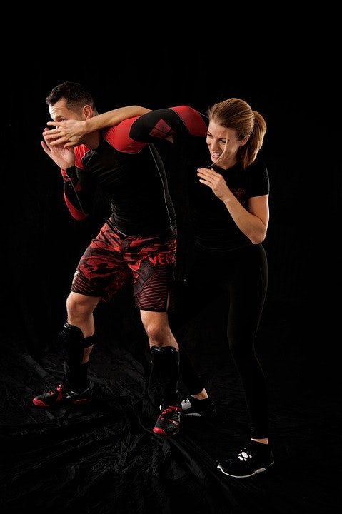 Man and woman doing a self-defense technique
