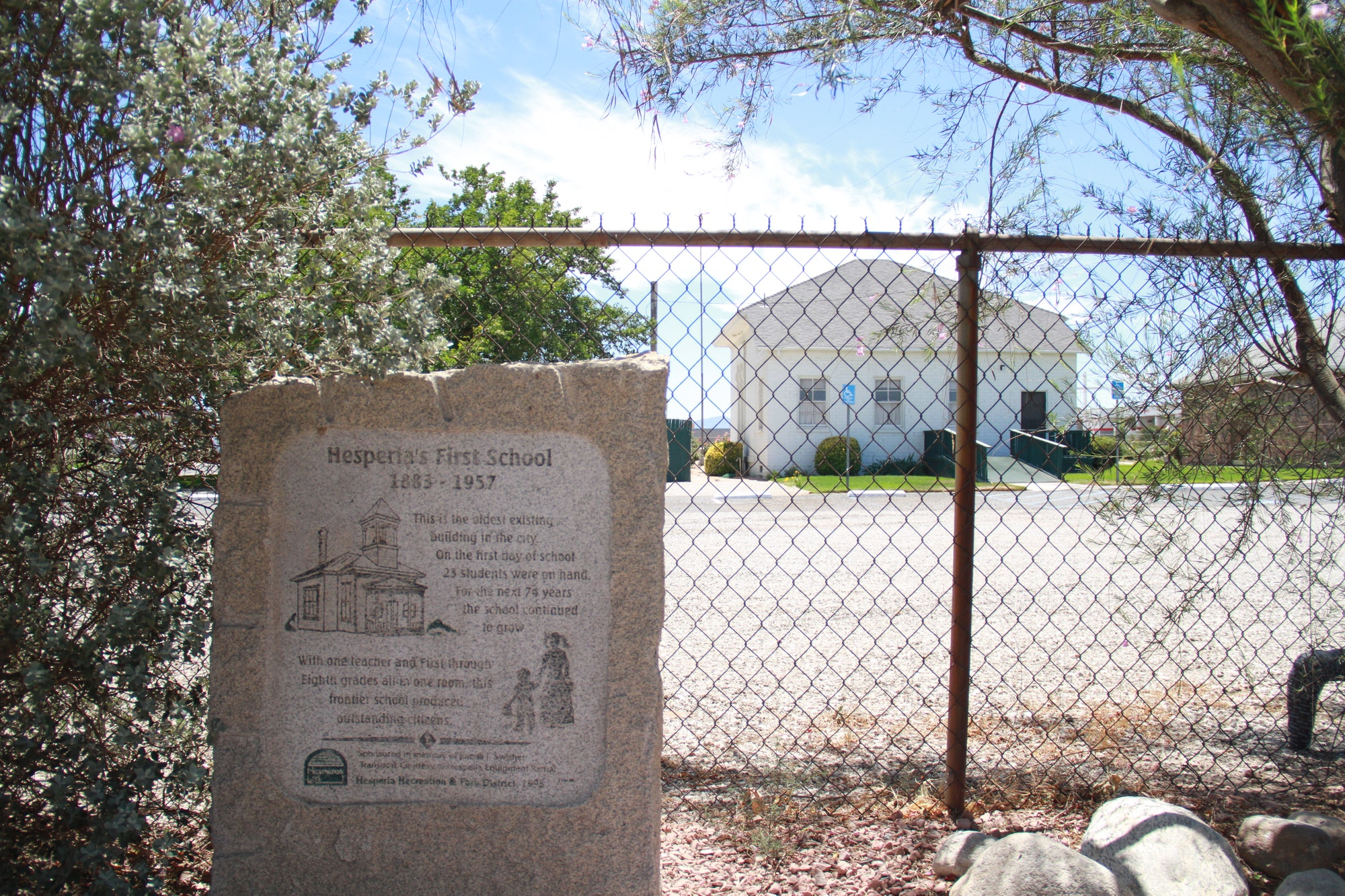 Hesperia Historical Site flagstone sign in front  of firs ever Hesperia school