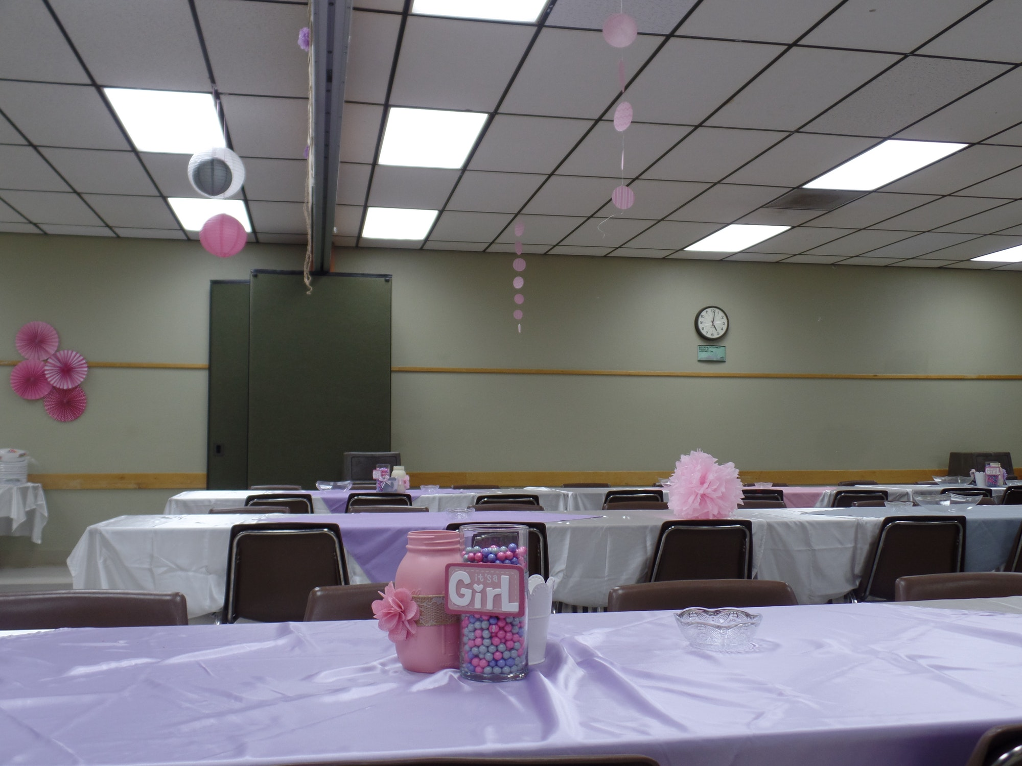 Inside Mojave Rooms at Lime Street Park Community Center with tables set up for a girl baby shower
