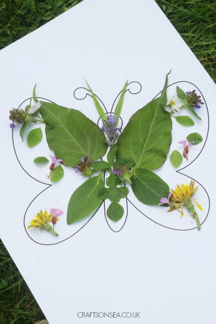 Butterfly template with leaves and flowers on it