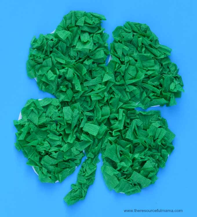 Paper four leaf clover covered with green crepe paper