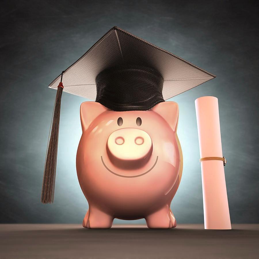Piggy bank with a graduation cap and diploma