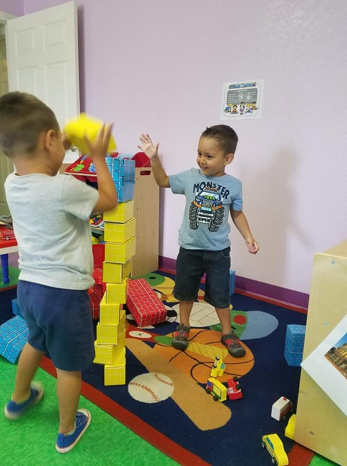 2 kids playing with blocks at Learn n' Play
