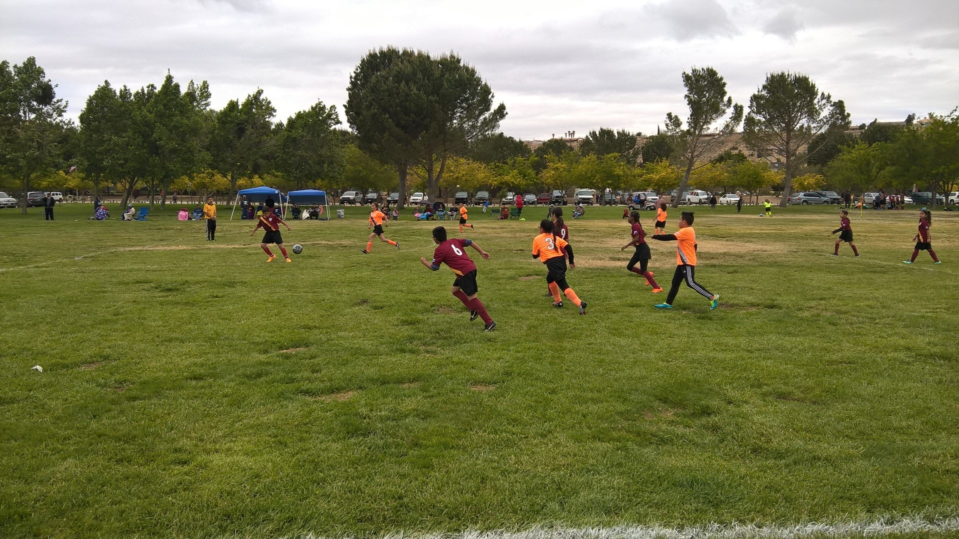 Kids playing soccer at the soccer fields located at Hesperia Lake Park