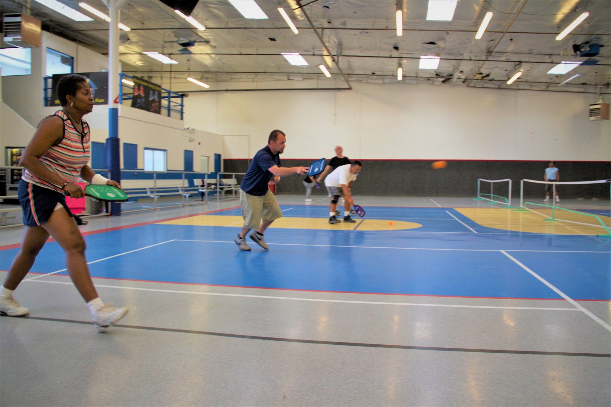 Adults playing pickleball at Power Play Center