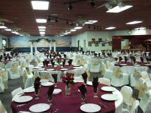 Inside view of Percy Bakker facility with tables set up for an event