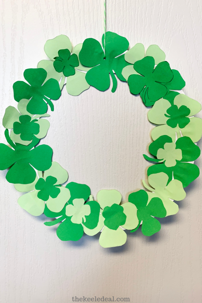 Paper plate wreath with paper four leaf clovers covering it
