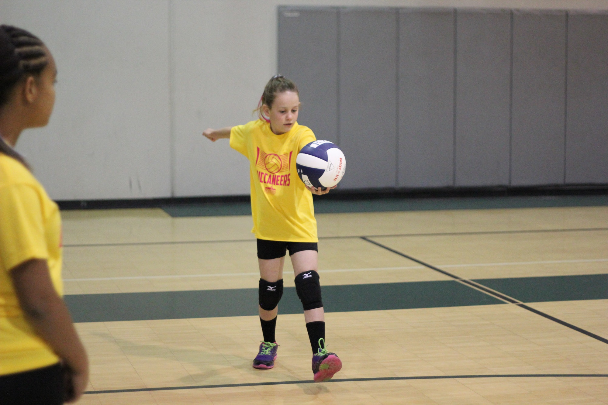 Little girl about to hit a volleyball