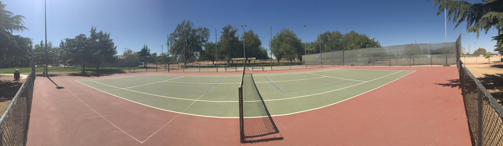 Panoramic view of tennis courts at Lime Street Park