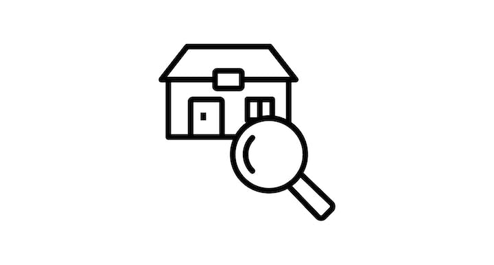 house with magnify glass icon