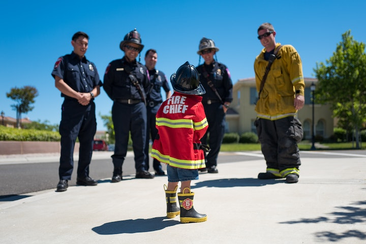 May contain: apparel, footwear, clothing, shoe, human, person, fireman, and helmet