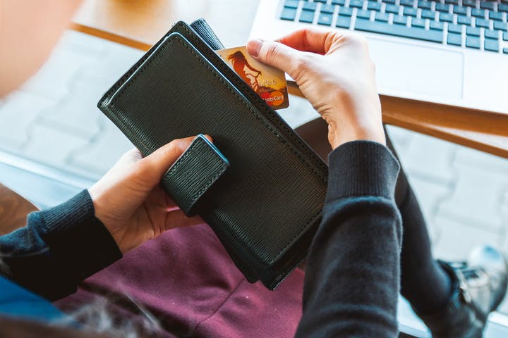 Image of a person paying their bill online