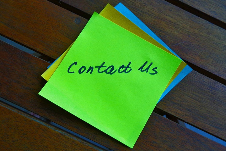 Image of post-it notes saying contact us