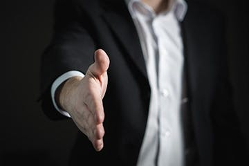Image of a guy shaking hands