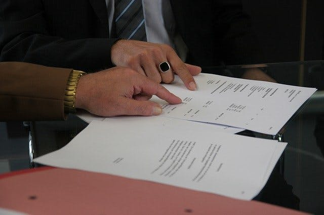 Image of a contract being signed