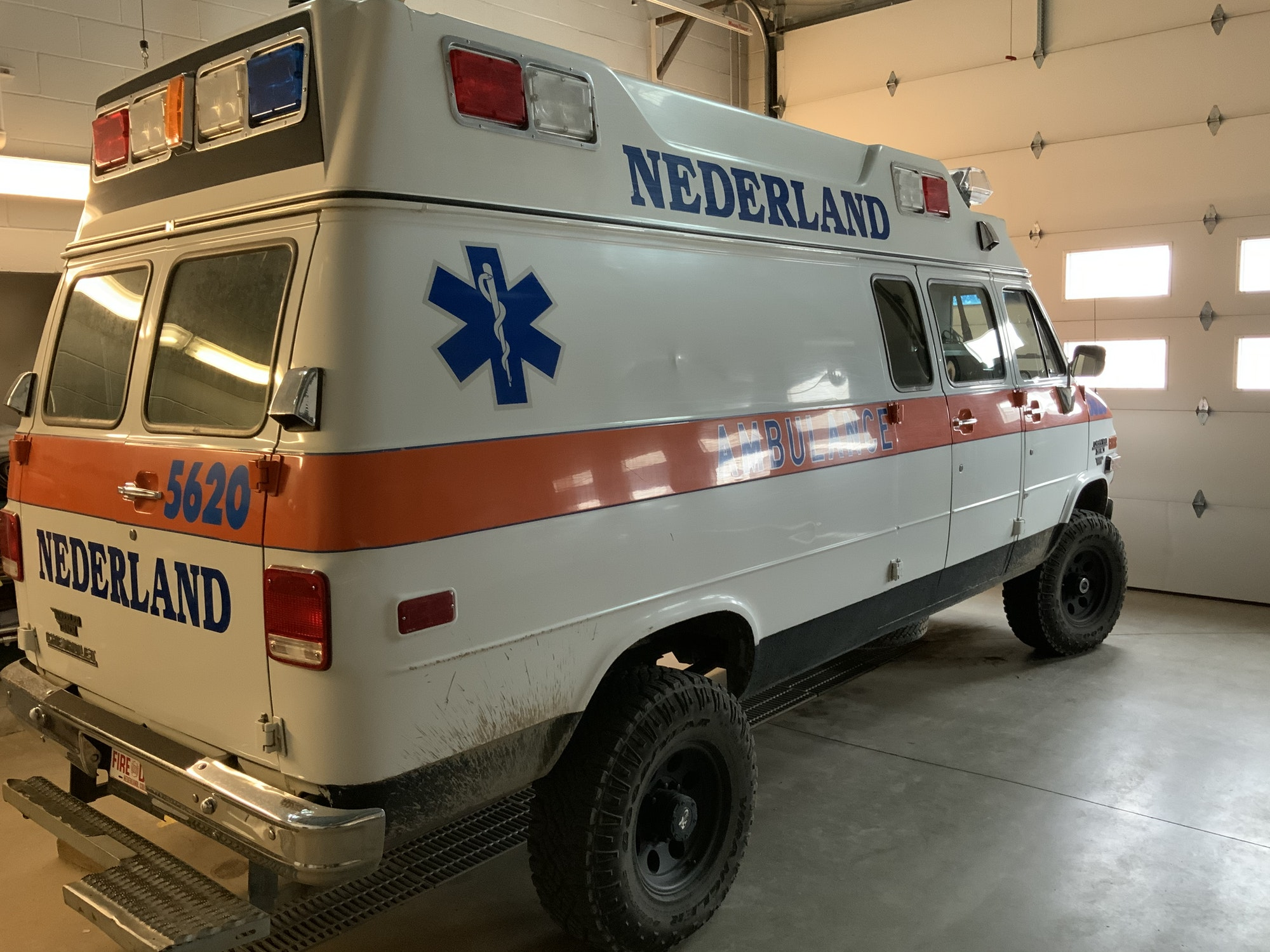 May contain: transportation, vehicle, truck, van, and ambulance