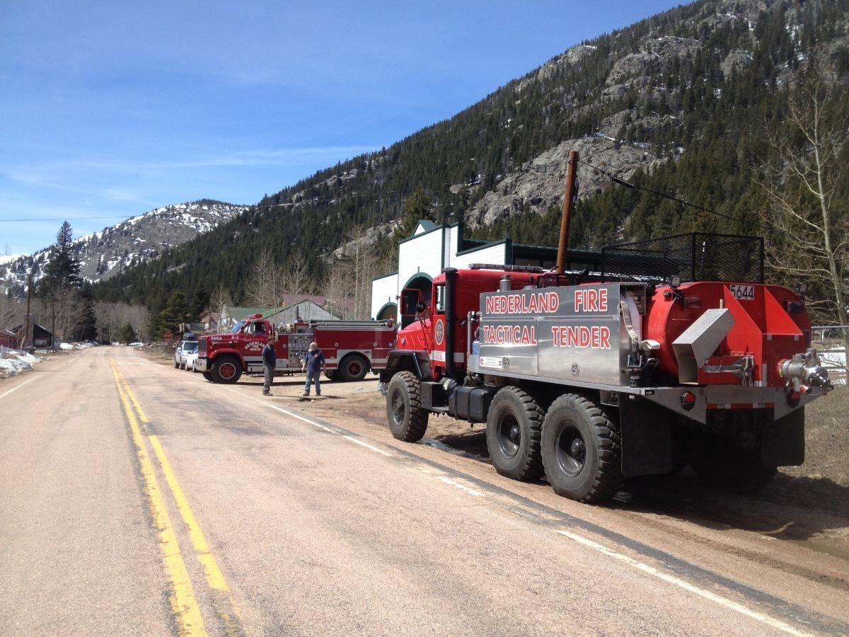 May contain: truck, transportation, vehicle, human, person, asphalt, and tarmac