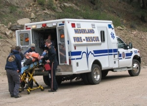 May contain: human, person, vehicle, transportation, van, ambulance, and truck