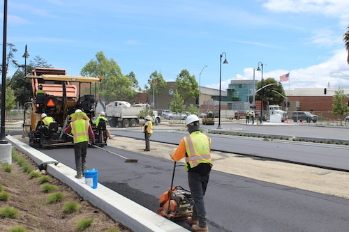 May contain: human, person, road, asphalt, and tarmac