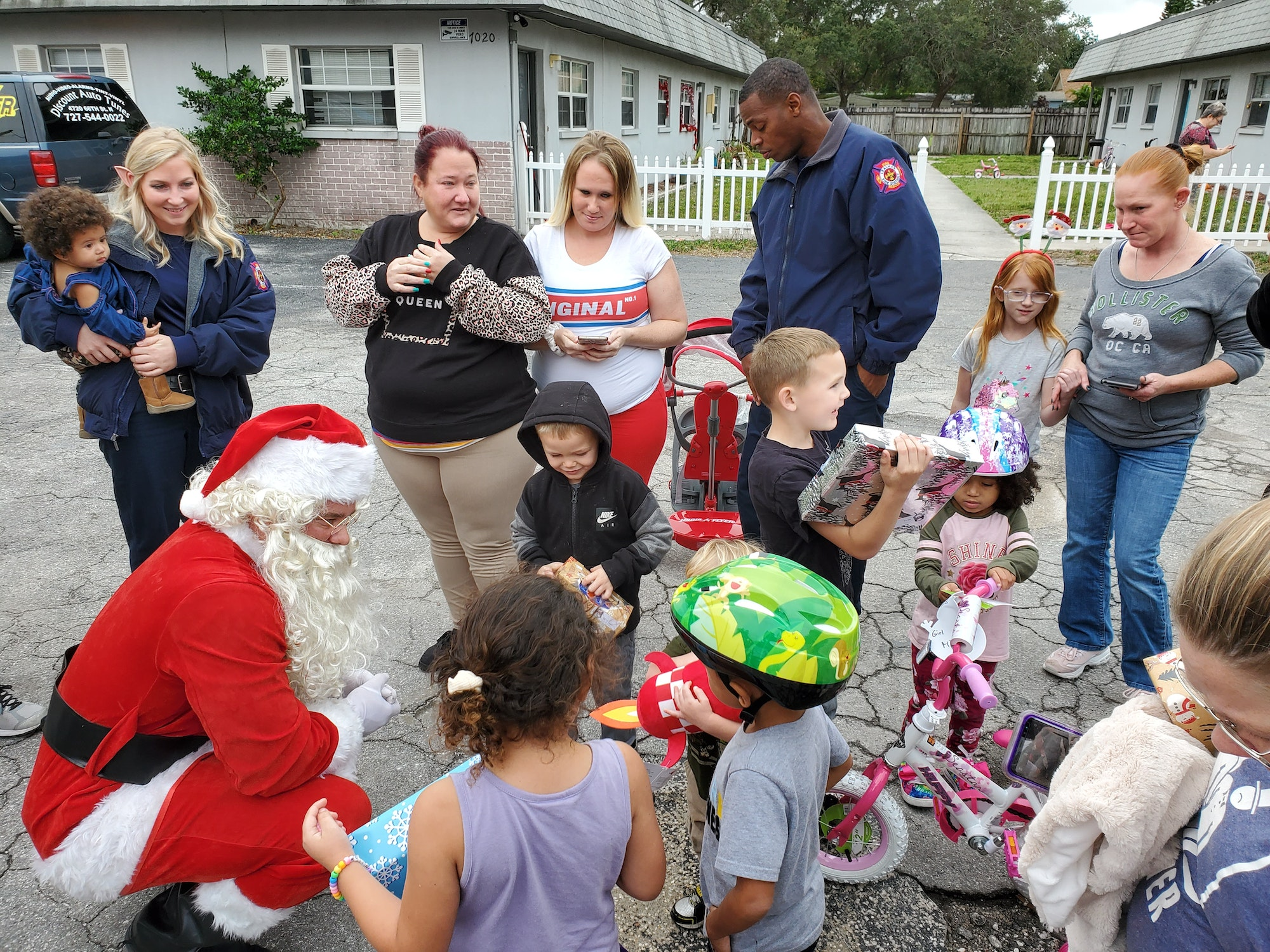 Santa talks to children while delivering gifts