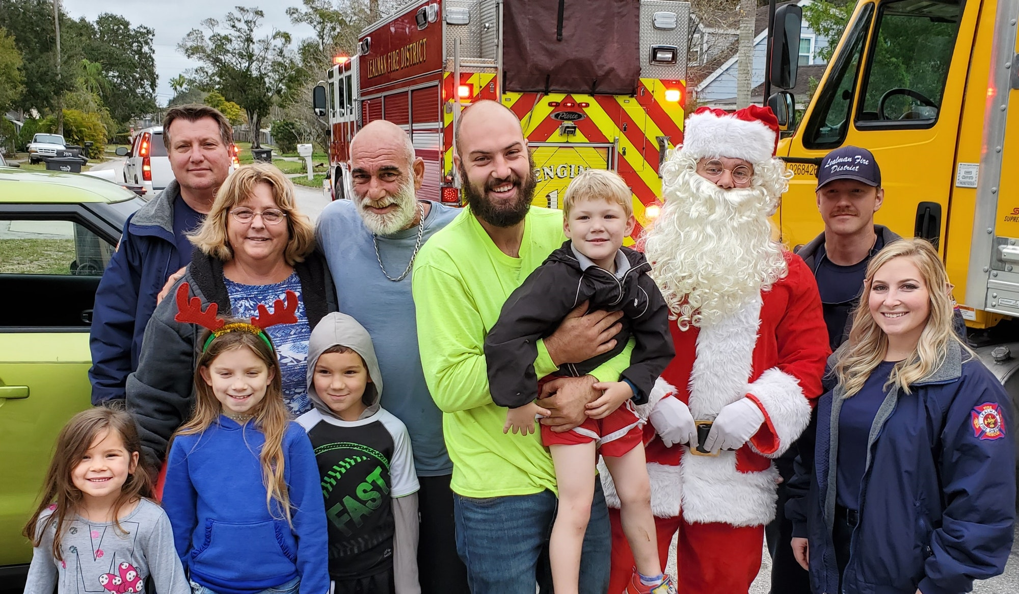 Picture of Santa with family during delivery, smiling kids