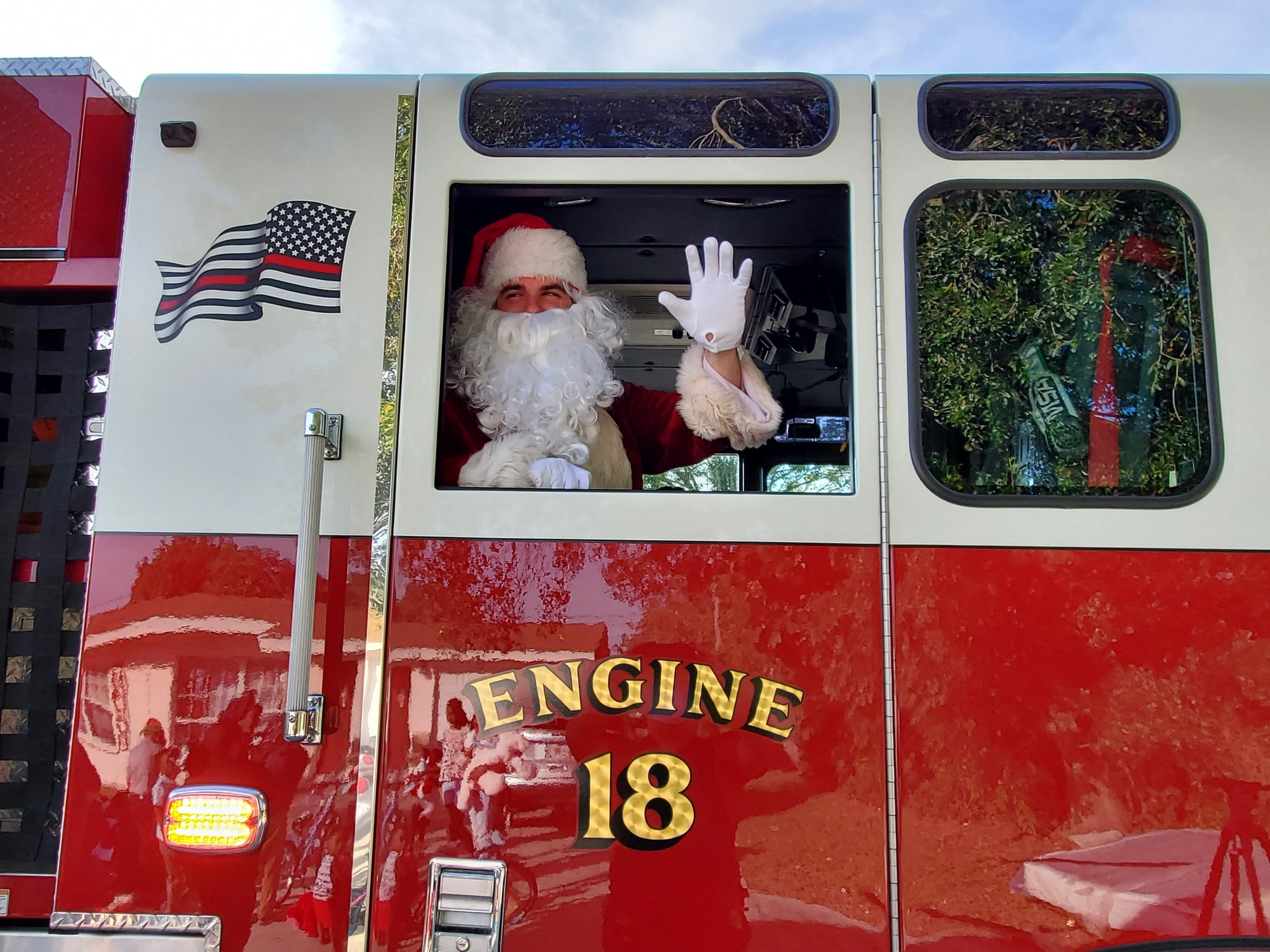 Santa waving from fire engine 18