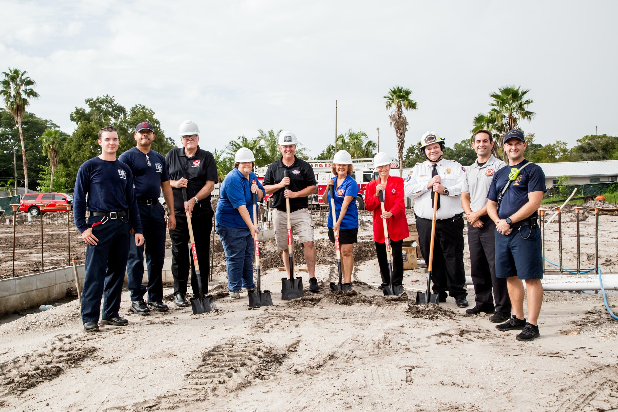 Men and Women pose for a picture, some with shovels 09/16/2021