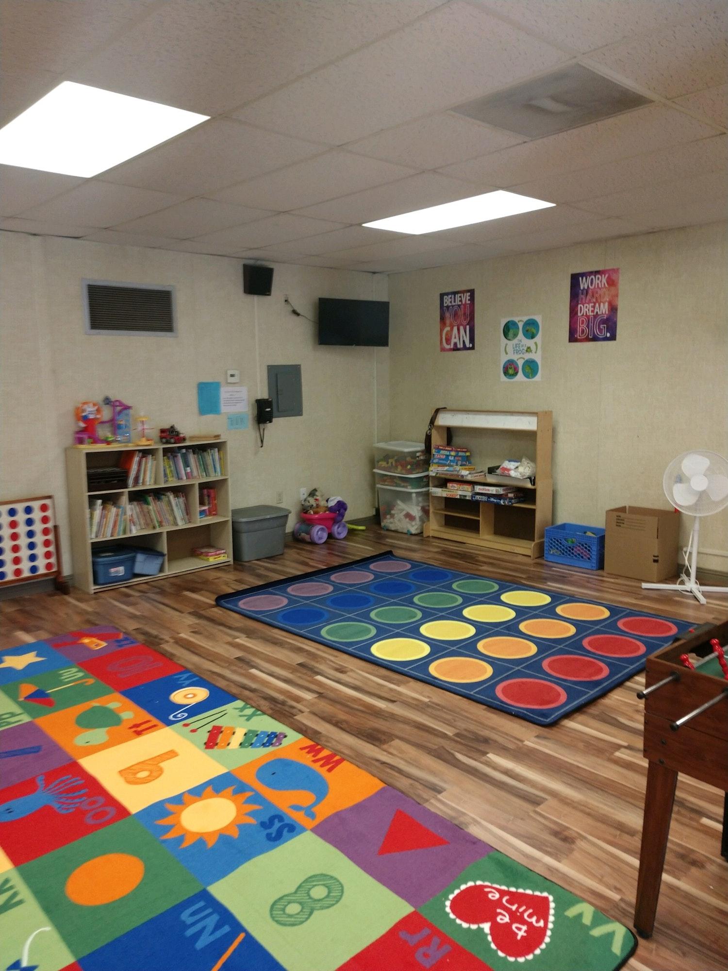 May contain: rug, indoors, room, flooring, and kindergarten