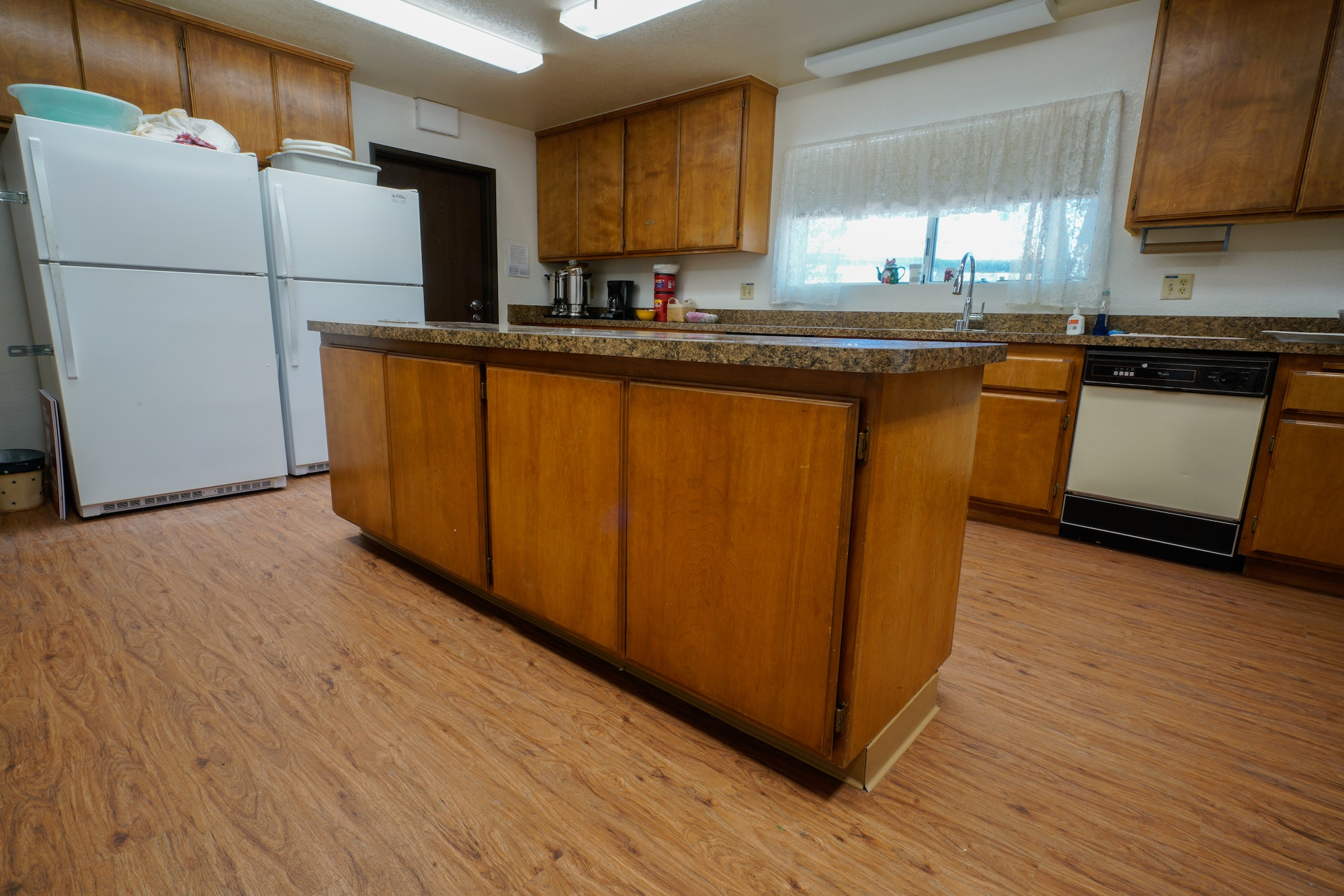 May contain: flooring, wood, hardwood, floor, indoors, room, and kitchen