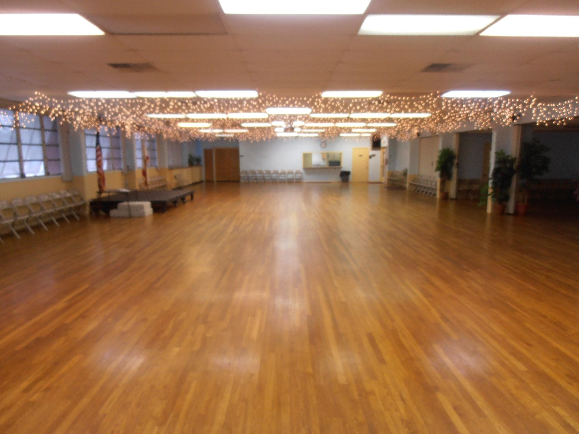 May contain: floor, person, human, flooring, wood, indoors, hardwood, and room